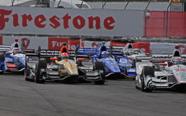 First lap – Will Power leads James Hinchcliffe and others out of turn 1.  [Joe Jennings Photo]