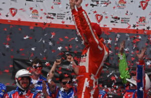 In victory lane, Sebastien Bourdais salutes TV cameras. [Joe Jennings Photo]