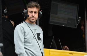 Fernando Alonso watches the final warmup from the Andretti Autosport pit stand at Barber Motorsports Park. [Photo by: Christopher Owens]