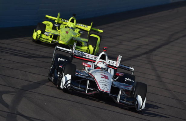 Teammates Helio Castroneves and Simon Pagenaud sail into Turn 1 during practice for the Desert Diamond West Valley Phoenix Grand Prix. [Photo by: Chris Owens]