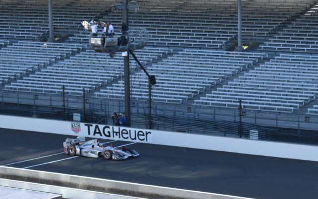 Will Power takes the checkers and the win at the IndyCar Grand Prix.  [John Wiedemann Photo]