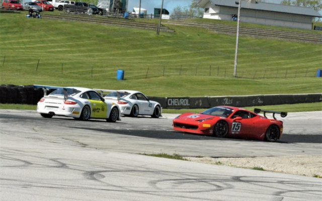 #15 Colin Cohen (FERRARI 458 CHALLENGE) loops his car in turn 5 as #161 Jeffrey Freeman and #42 Thomas Pank go by.  [Dave Jensen Photo]