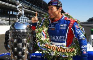 Takuma Sato poses with the Borg-Warner Trophy after winning the Indianapolis 500. [Russ Lake Photo]
