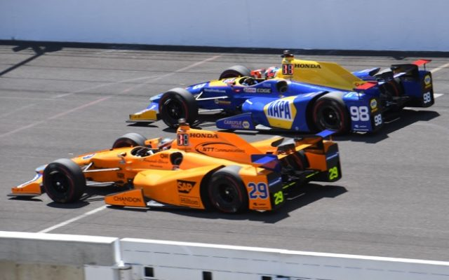 Alexander Rossi on the outside of Fernando Alonso during Indy 500 practice.  [Russ Lake Photo]