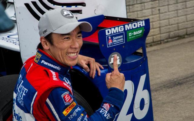 Takuma Sato poses with the P1 award sticker.  [Andy Clary Photo]