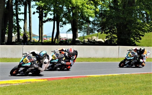 #118 Benjamin Smith (KTM), #321 Jake Leahey (KTM) and #618 Jackson Blackmon (KTM) in turn 6 at the start of the KTM RC CUP race #2 at Road America.  [Dave Jensen Photo]