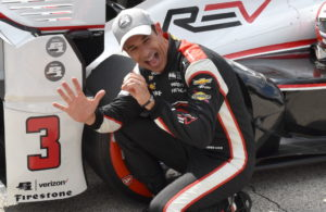 Helio Castroneves puts the Verizon P1 Award sticker on after capturing his 50th career pole. [John Wiedemann Photo]