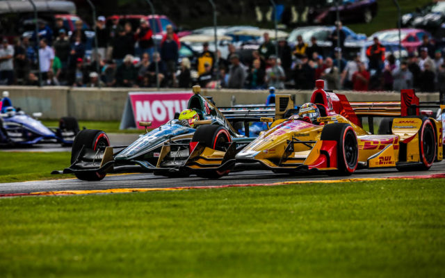 Spencer Pigot and Ryan Hunter-Reay battle for position.  [Andy Clary Photo]