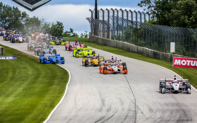 The start of the Kohler Grand Prix with Helio Castroneves leading the pack into turn three at Road America.  [Andy Clary Photo]