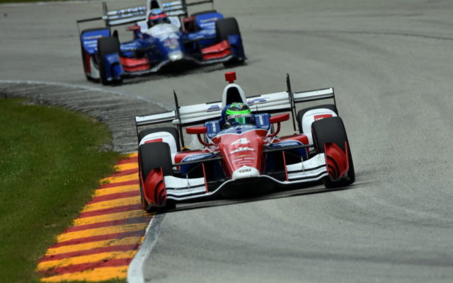 Conor Daly leads Takuma Sato into turn 13 at Road America.  [John Wiedemann Photo]