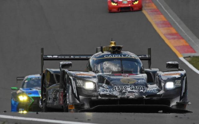 The winning Action Express Racing Cadillac climbs hill headed to turn 9.  [Joe Jennings Photo]