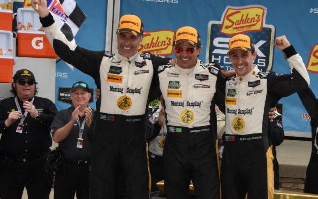 Race winners Joao Barbosa, Christian Fittipaldi and Felipe Albuquerque celebrate atop their winning car.  [Joe Jennings Photo]