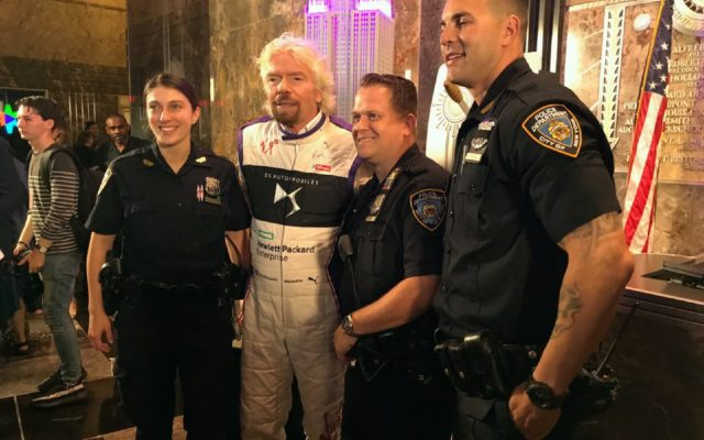 Richard Branson posing with New York's finest. [Eddie LePine Photo]