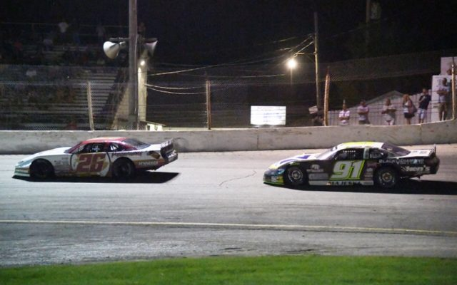 Bubba Pollard makes the winning pass on Ty Majeski at the Slinger Nationals.  [Russ Lake Photo]
