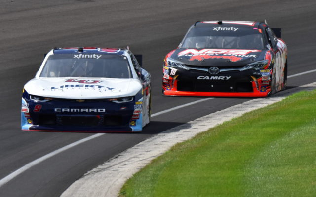 William Byron in front of Kyle Busch in the Lilly Diabetes 250 at Indianapolis.  [John Wiedemann Photo]