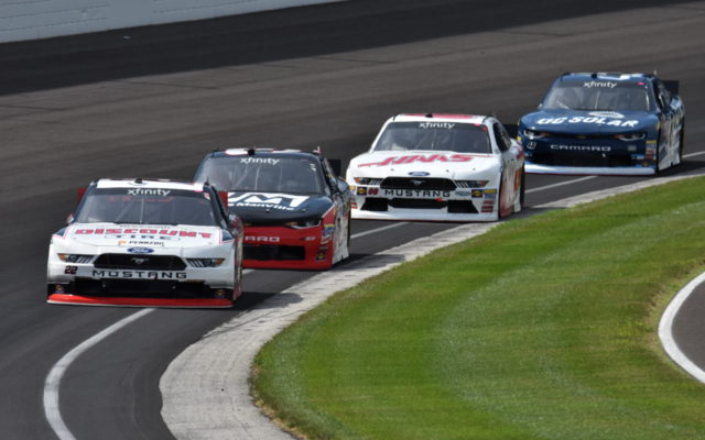 Joey Logano leads a pack of Xfinity Series competitors at Indianapolis.  [John Wiedemann Photo]