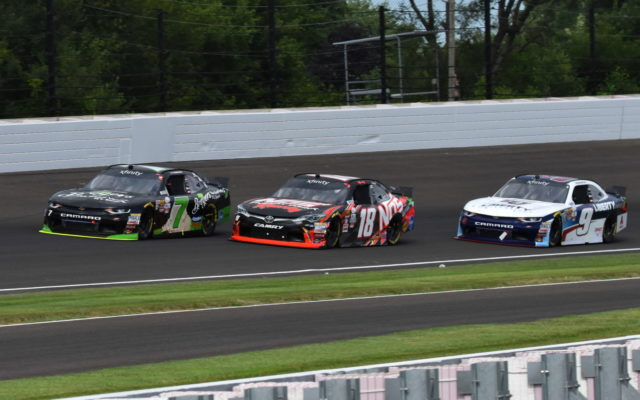 Justin Allgaier leads Kyle Busch and William Byron prior to the end of Stage 2.  [John Wiedemann Photo]