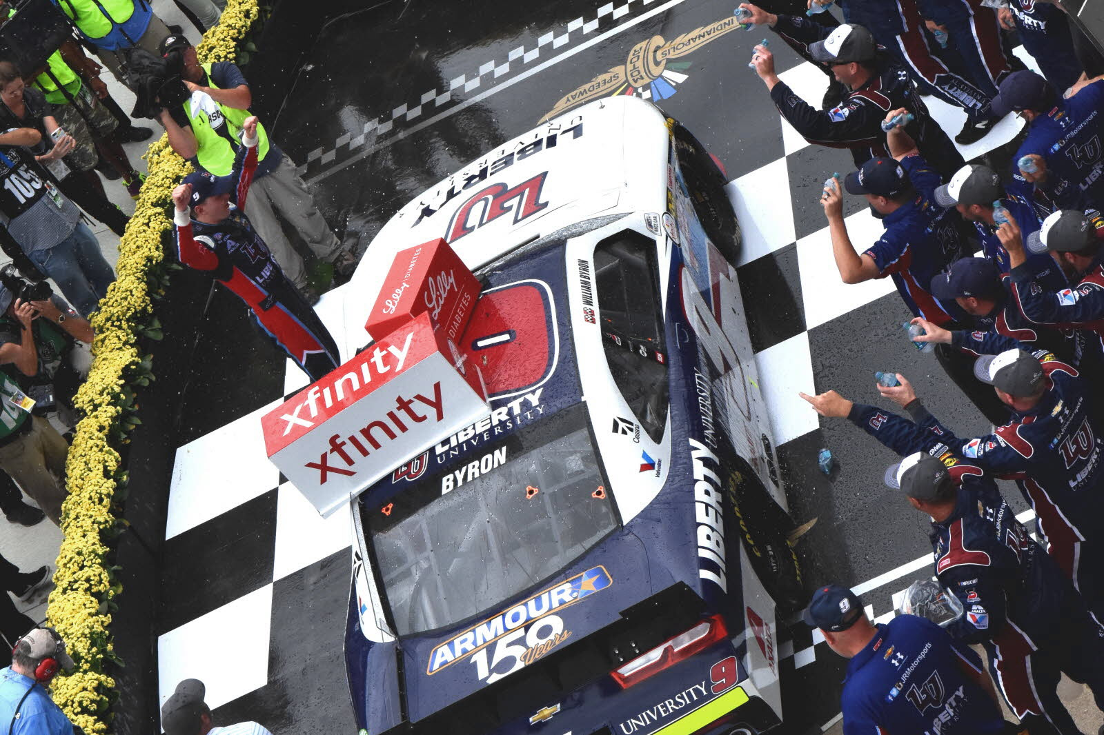 William Byron celebrates with his team in victory lane after winning the Lilly Diabetes 250 at Indianapolis. [John Wiedemann Photo]