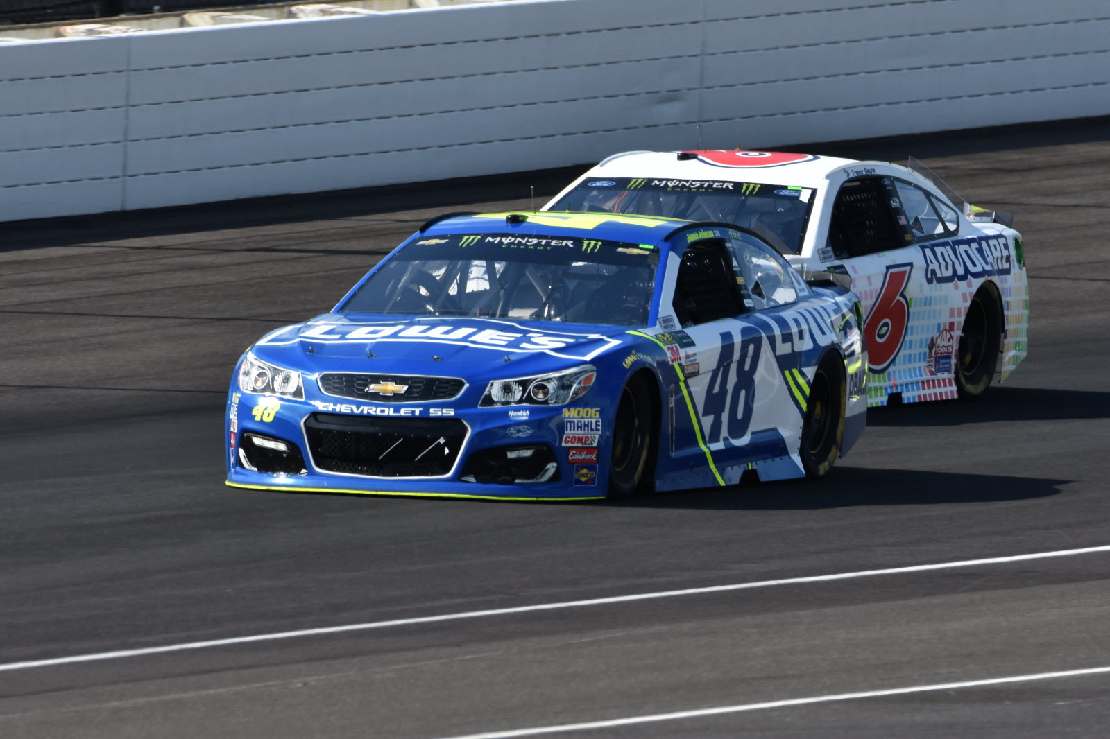 Jimmie Johnson races to the inside of Trevor Bayne. [John Wiedemann Photo]