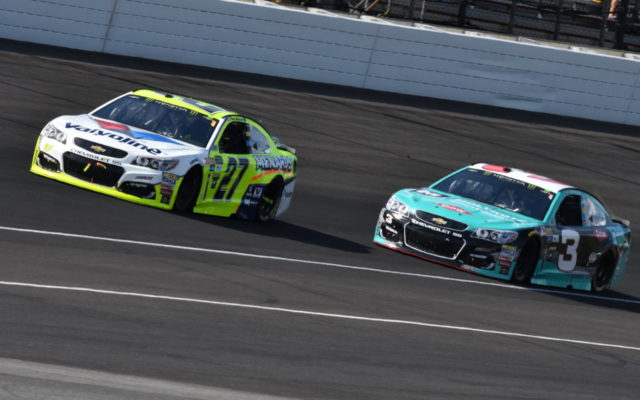 Paul Menard battles teammate Austin Dillon.  [John Wiedemann Photo]