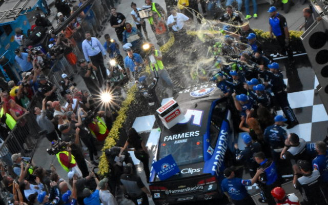 Kasey Kahne gets a celebratory shower from his crew after winning the Brickyard 400.  [John Wiedemann Photo]