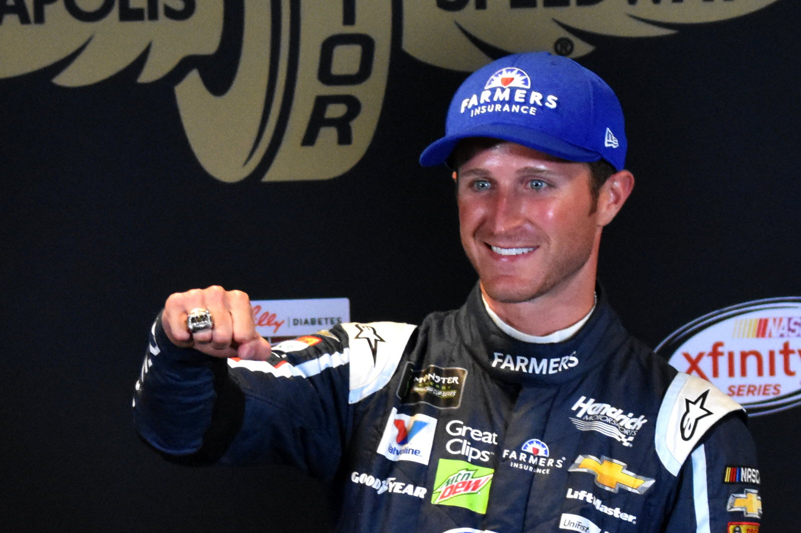Kasey Kahne shows off his winning ring after the Brickyard 400. [John Wiedemann Photo]