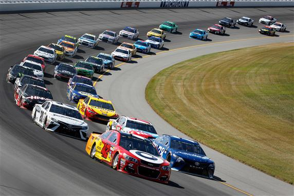 Kyle Larson and Martin Truex Jr. lead a pack of cars during at Michigan International Speedway. [Photo by Brian Lawdermilk/Getty Images]
