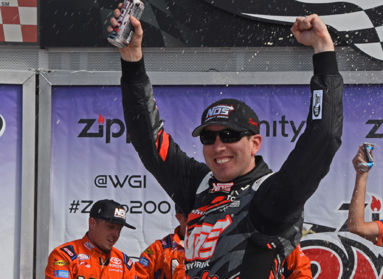 Kyle Busch all smiles in victory lane after scoring his first Xfinity win at the Glen. [Joe Jennings Photo]
