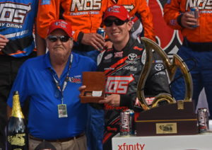 Victor Kyle Busch receives gold Zippo lighter from Zippo president. [Joe Jennings Photo]