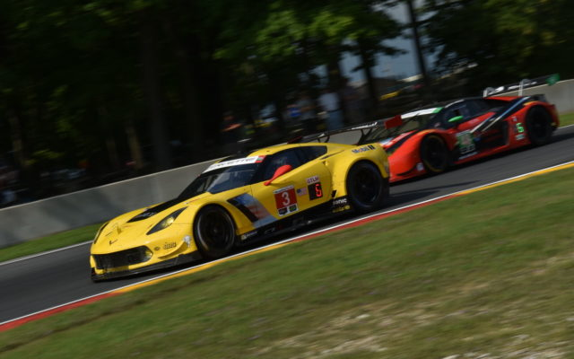 GTLM Corvette C7.R races the Lamborghini Huracan GT3 into turn six.  [John Wiedemann Photo]