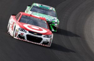 Kyle Larson races Kyle Busch during the Monster Energy NASCAR Cup Series Pure Michigan 400 at Michigan International Speedway. [Credit: Gregory Shamus/Getty Images]