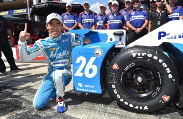 Takuma Sato celebrates his Verizon P1 Award for winning the pole for the ABC Supply 500 at Pocono Raceway. [Photo by: Chris Owens]