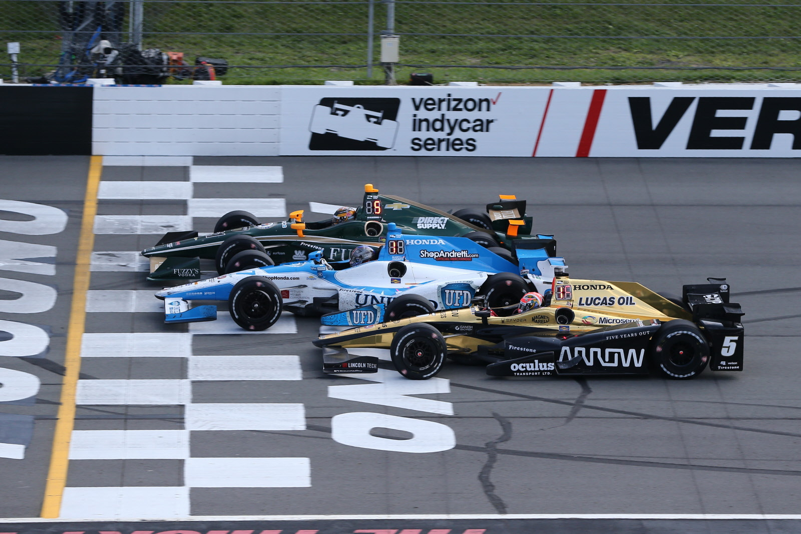 Three wide action in the ABC Supply 500 at Pocono Raceway. [Chris Jones Photo]