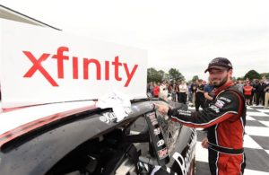 Jeremy Clements poses with the winners sticker after the NASCAR XFINITY Series Johnsonville 180 at Road America. [Credit: Stacy Revere/Getty Images]