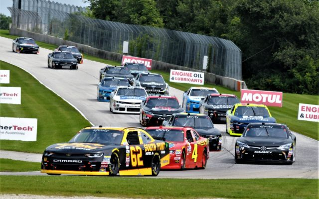 #62 Brendan Gaughan, #4 Ross Chastain lead the pack into turn 3 at Road America Xfinity race.  [Dave Jensen Photo]