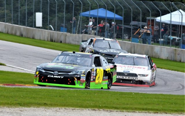 #20 James Davison, #22 Austin Cindric and #42 Justin Marks in turn 3 in NASCAR Xfinity race.  [Dave Jensen Photo]