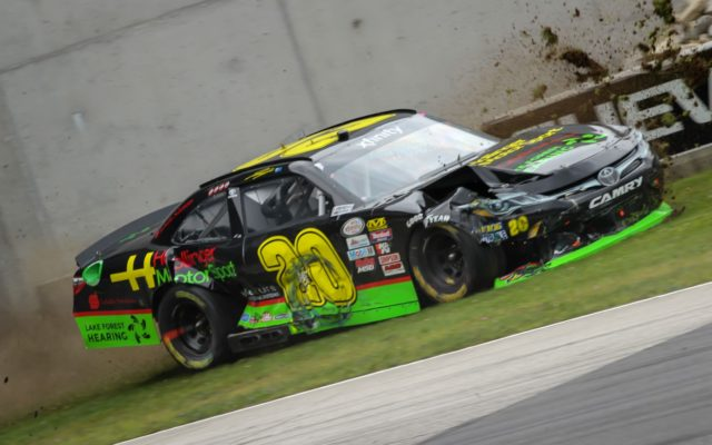 #20 James James Davison smacks the bridge at turn 6 after wrecking coming up the hill.  [Tyler Jensen Photo]