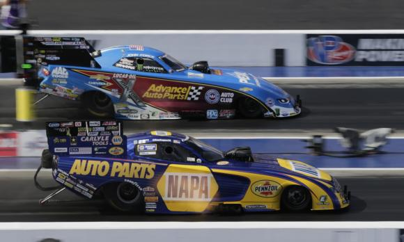 Sixteen-time NHRA Funny Car champion John Force and 2016 champion Ron Capps battle during last season's NHRA Carolina Nationals at zMAX Dragway. (CMS/HHP photo)