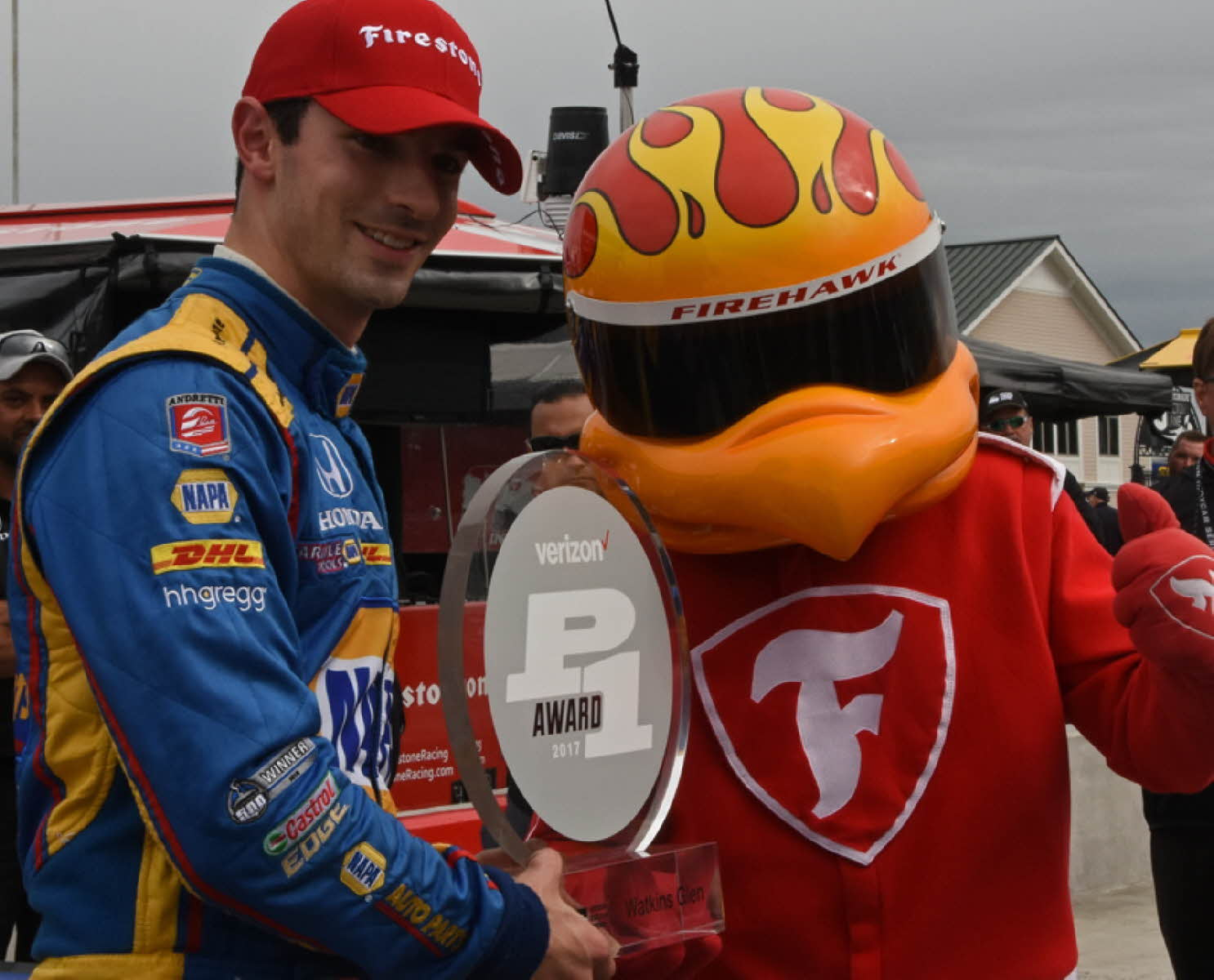 Alexander Rossi all smiles as he holds his first-ever Verizon P1 pole award. [Joe Jennings Photo]