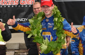 Wearing the traditional Watkins glen winner's wreath, Alexander Rossi is all smiles. [Joe Jennings Photo]