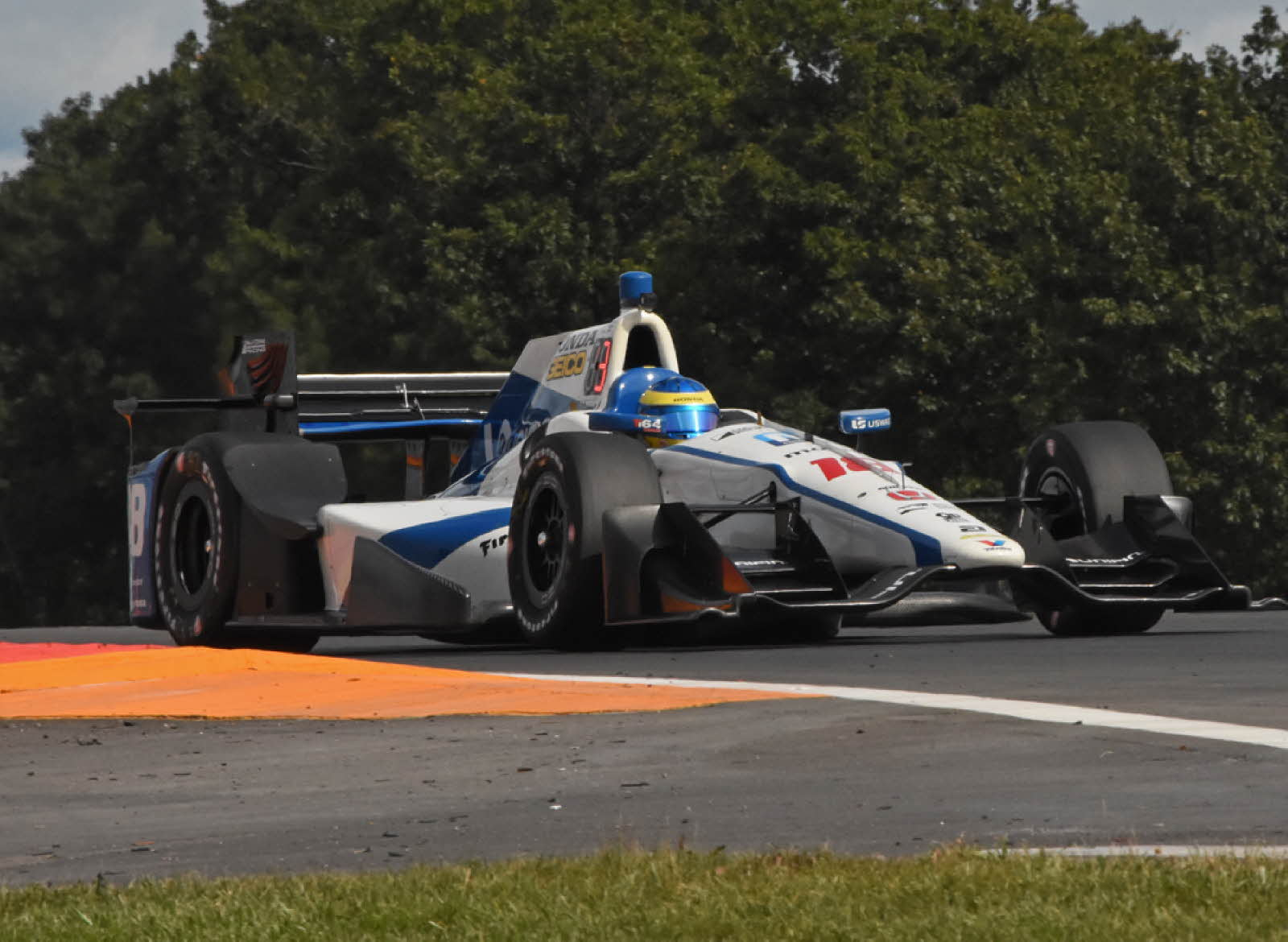 At Watkins Glen, Sebastien Bourdais powers out of inner loop. [Joe Jennings Photo]