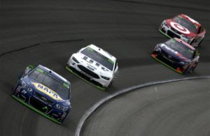 Chase Elliott leads Brad Keselowski, Denny Hamlin and Kyle Larson during the Monster Energy NASCAR Cup Series Tales of the Turtles 400 at Chicagoland Speedway. [Photo by Sean Gardner/Getty Images]