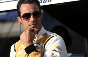 Helio Castroneves looks down pit lane. [Photo by: Chris Jones]