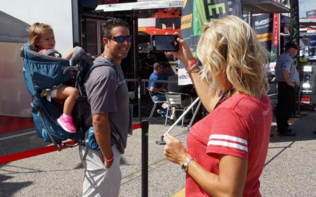 Race fans enjoying the paddock.  [Photo by Jack Webster]