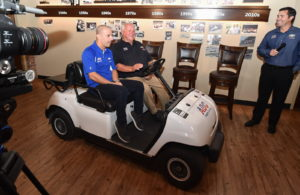 Tony Kanaan and AJ Foyt arrive at the driver announcement on AJ's golf cart. [Chris Owens Photo]
