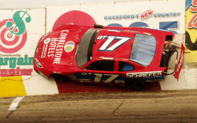 Grant Griesbach gets up and rides the turn 4 wall at Rockford Speedway.  [Roy Schmidt Photo]
