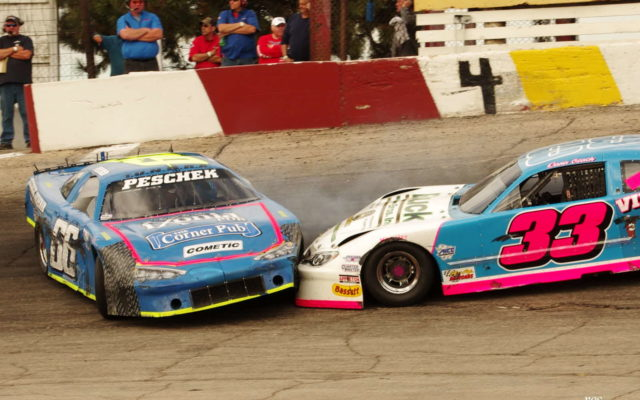 Adam Peschek and Dana Czach colide at Rockford.  [Roy Schmidt Photo]