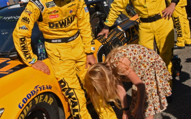 Matt Kenseth's eldest daughter tends to his racing boots.  [Joe Jennings Photo]