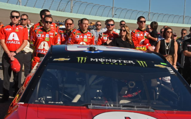 Dale Earnhardt Jr.'s crew assemble for the National Anthem in a cordoned-off area.  [Joe Jennings Photo]