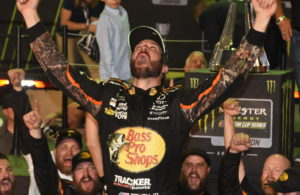 New Cup champion Martin Truex Jr. gives victory cheer atop his car. [Joe Jennings Photo]
